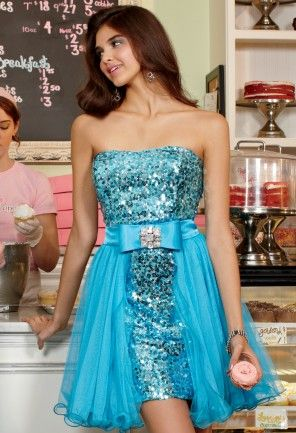 Maximize your flirt potential at your Prom night bash or Homecoming party with this short turquoise and metallic silver bodycon sequin strapless dress by Betsy