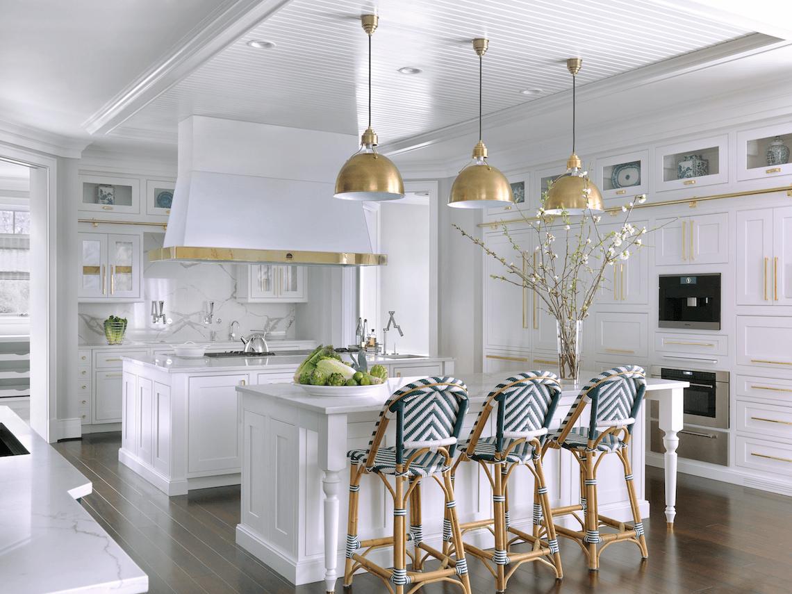 White Kitchen Cabinetry Polarstone Countertops Brass Hardware And Visual Comfort Lighting Pair Beautiful Kitchen Cabinets Interior Design Kitchen Home Decor