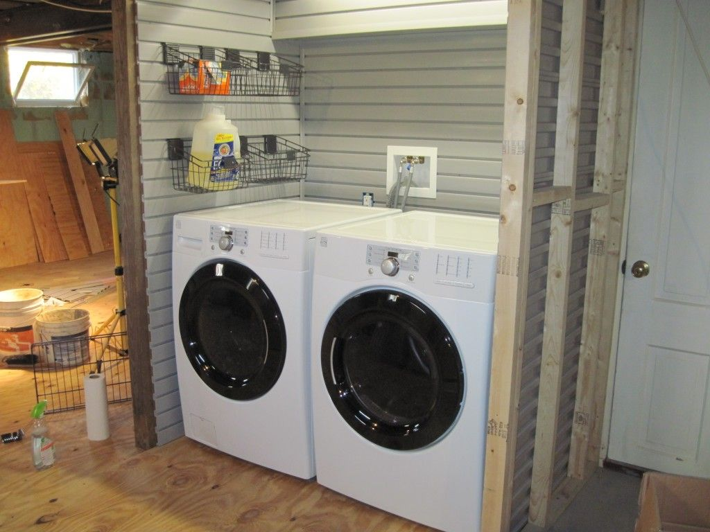Using slatwall for laundry room organization to finish for Garage laundry room design