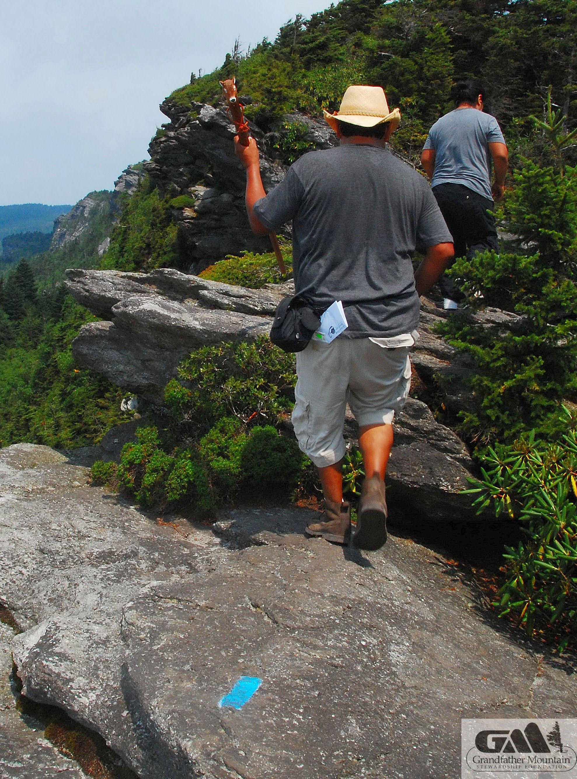 Hiking gear, the proper clothes and trail map are a must for ...