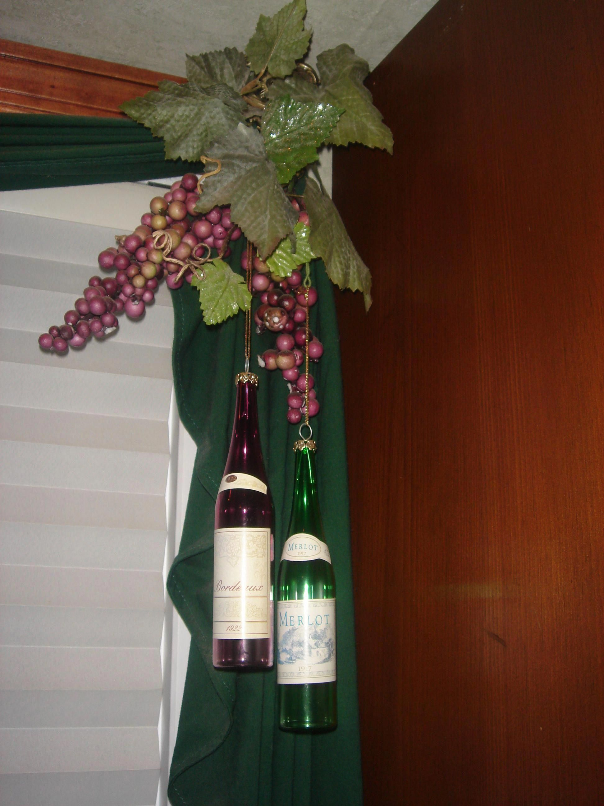 Wine Bottle Ornaments Hanging From Curtains In A Wine Themed Kitchen Tuscankitchens Wine Decor Kitchen Wine Theme Kitchen Farm Kitchen Decor