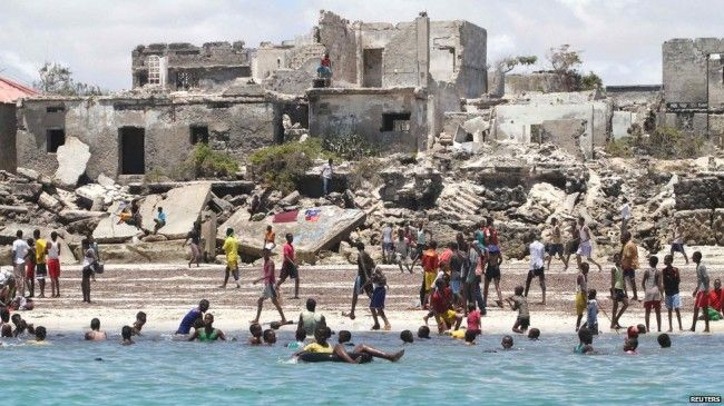 Mogadishu. Residents swim at Lido beach surrounded by buildings scarred by Somalia's two-decade civil war. The AU and Somali government army.