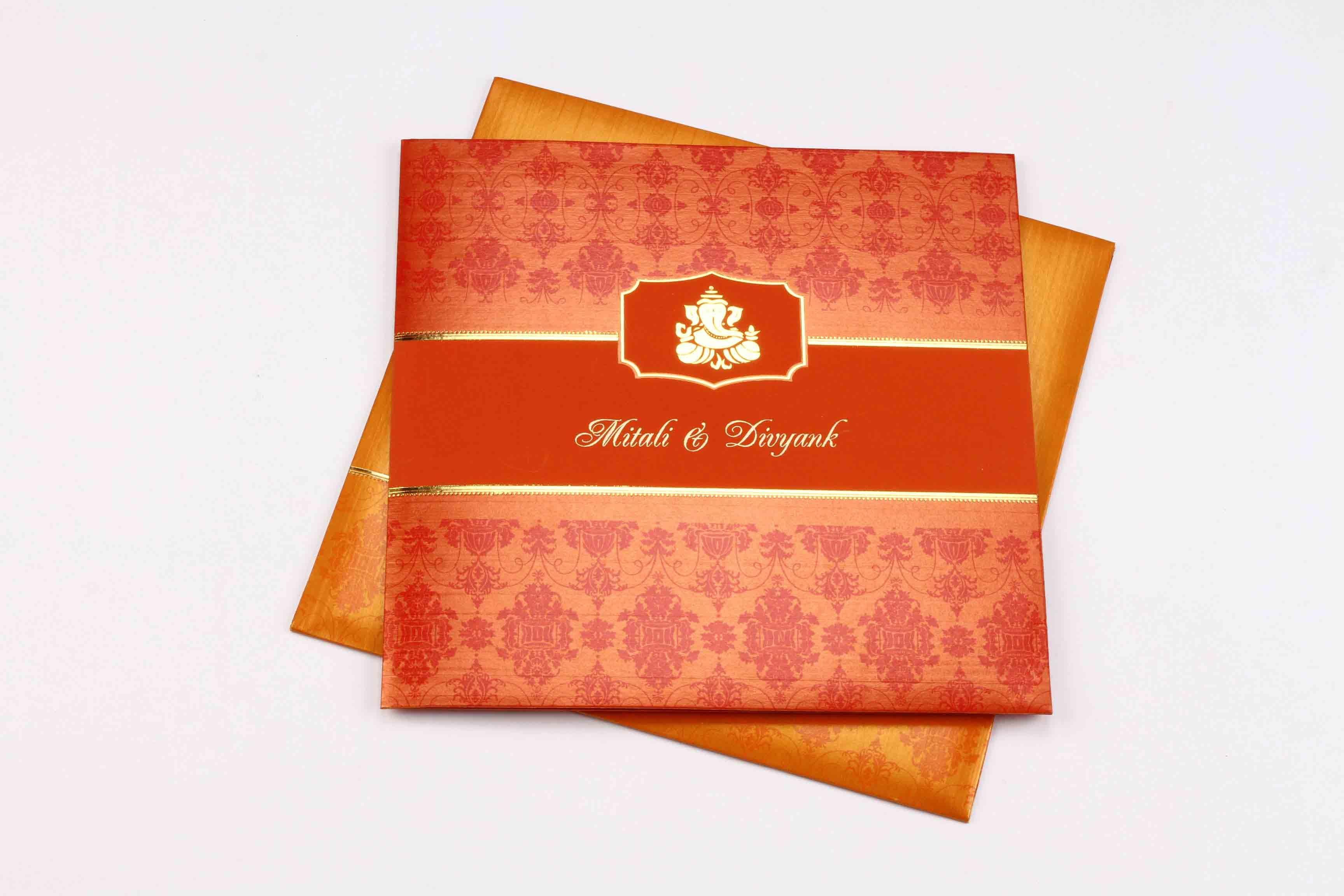 Orange Colored Hindu Wedding Invite | Ganesha themed wedding ...