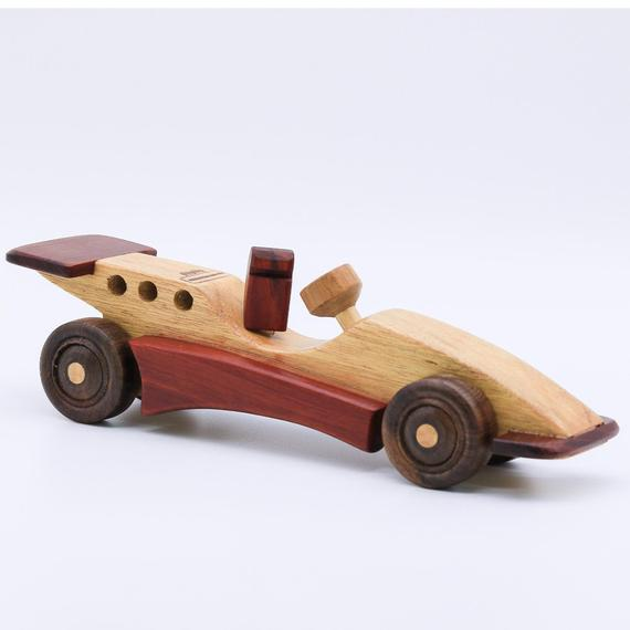 Personalized Wooden Race Car This Toy Wooden Race Car Will Make A Wonderful Gift For A Boy Or Girl 3 Year Old Each Wooden Kids Wooden Toys Wooden Toys