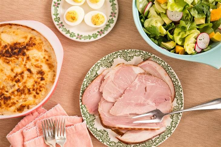 an easy make-ahead Easter dinner plan with ham, scalloped potatoes, deviled eggs, and a lemon tart