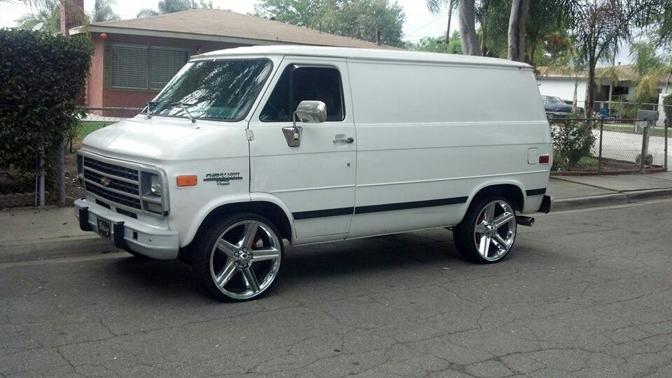 Shorty Chevy Van With Big Wheels And Low Profile Tires