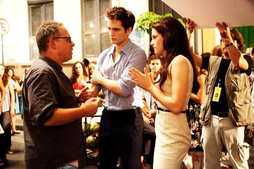 Bill Condon, Pattinson, and Stewart, on set of BREAKING DAWN PART I
