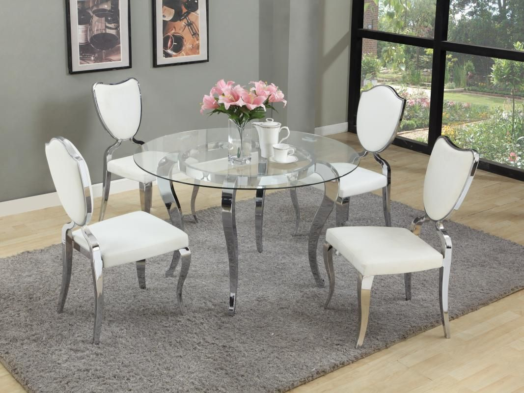 Round Glass Dining Table With Chrome Base And White Chairs Bring A Modern Design To Yo Round Dining Table Sets Round Dining Room Sets Glass Round Dining Table