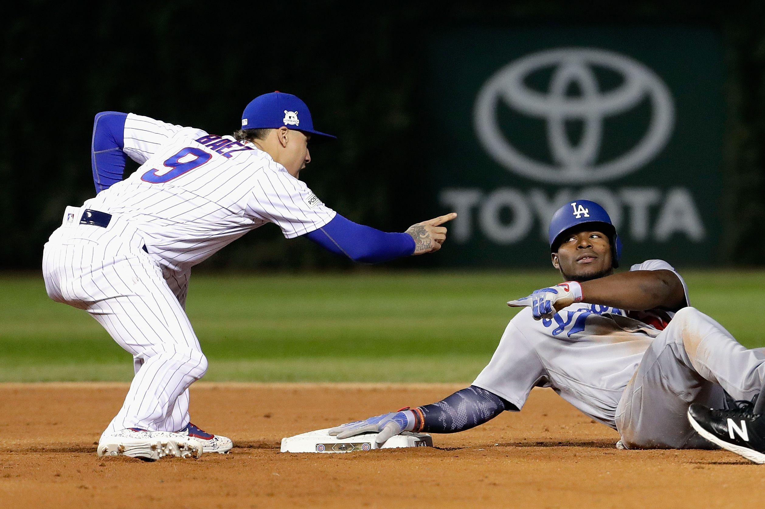 Javy Baez Gives Yasiel Puig A Dikembe Mutombo Finger Wag After Tag Mlb Chicago Cubs Chicago Cubs Baseball Cubs Baseball