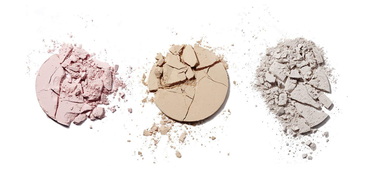 Cracked and broken make up powder compacts. Creative still