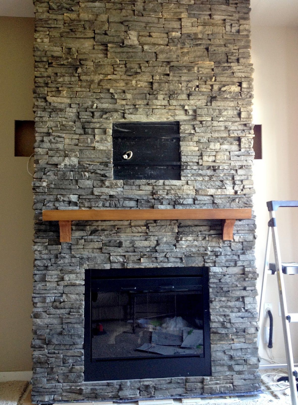 Excellent Stacked Stone Fireplace Design With Grey Stones