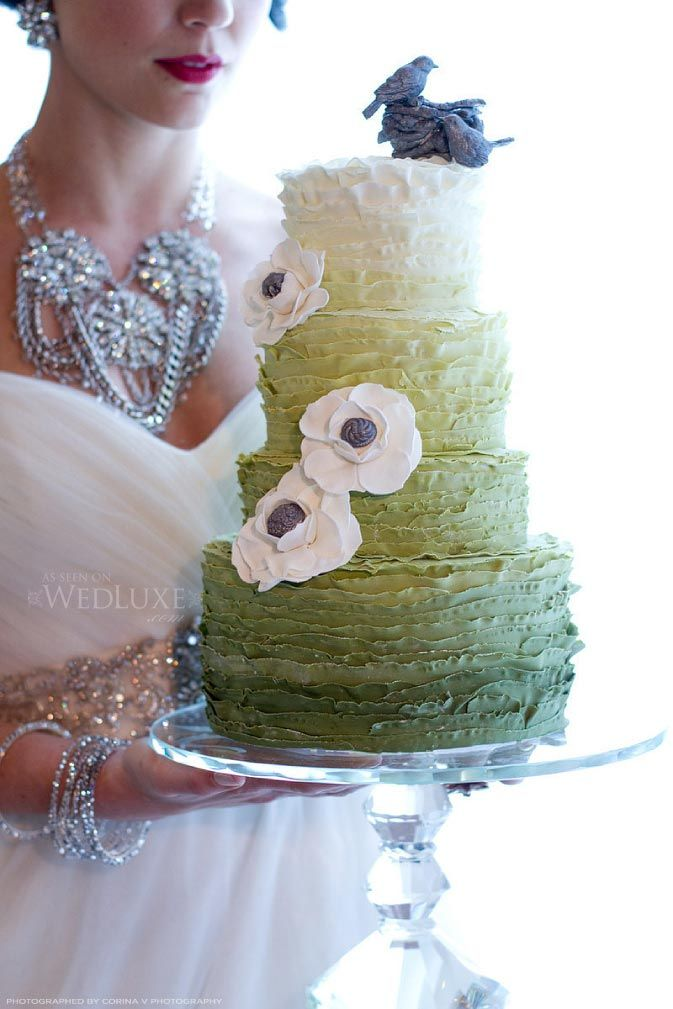 Ombre green ruffle cake with a bird on top! Love it
