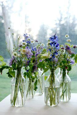 wild flowers in large bottles