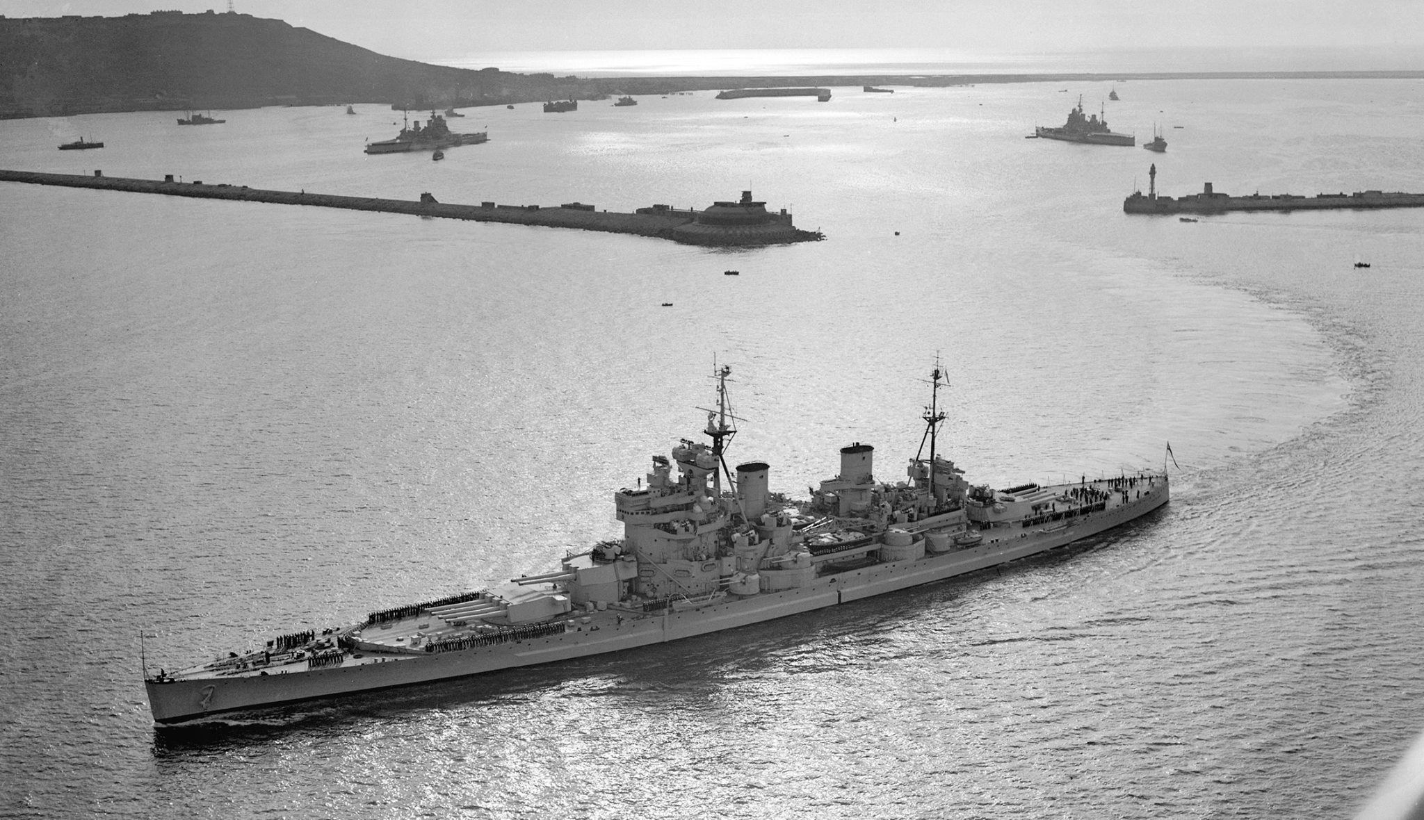 Another picture (see nearby) of 14 in King George V class battleship HMS Duke of York, 1944. Her sisters Anson and Howe are in the background.