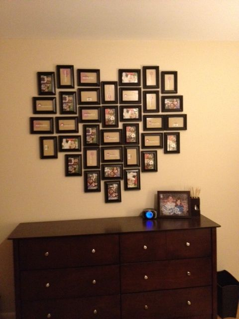 Make a heart of frames filled with wedding photos.. so cute!!