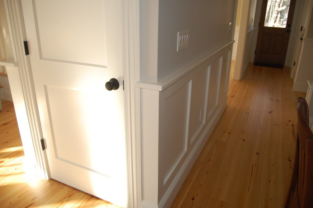Two panel door and wainscoting. dark bronze hardware