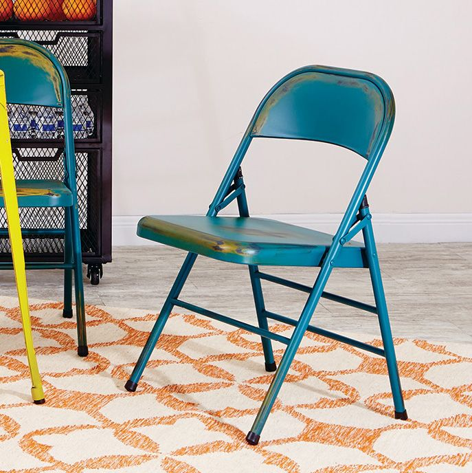The rustic industrial style of the OSP Designs Bristow folding chair is a modern take on the classic metal folding chair making it a stylish option for entertaining at home.
