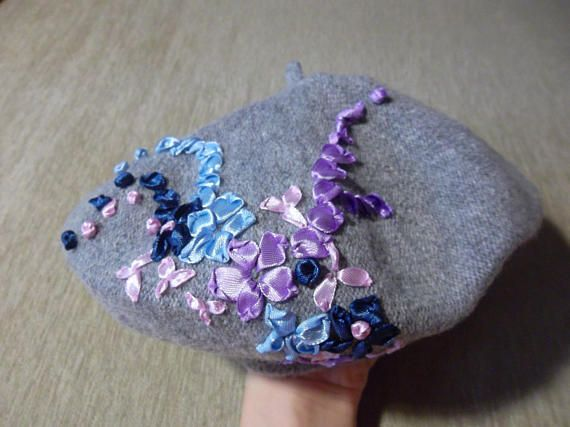 cc159dce33724 Gray beret decorated with flowers and snowflakes of ribbons ...