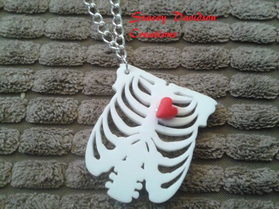 """White anatomical rib cage pendant on 21"""" silver necklace. �7"""