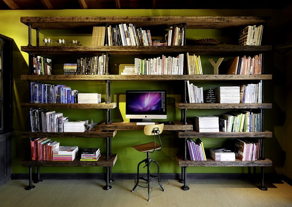 bookshelves and green walls in Industrial home office idea