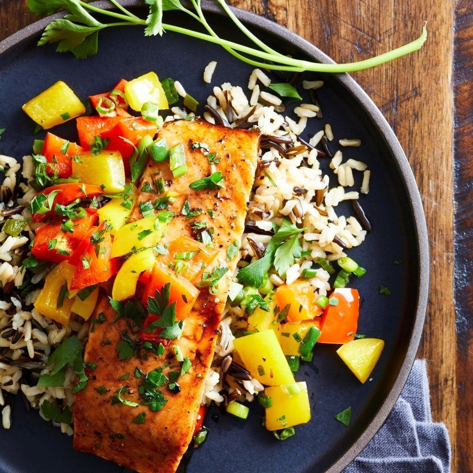 Sweet & Spicy Roasted Salmon with Wild Rice Pilaf #easyricepilaf Fresh jalapeños give this quick and easy roasted salmon dish its kick; honey and balsamic vinegar give it a sweet finish. A nutty-tasting wild rice pilaf completes this healthy dinner that comes together in just 30 minutes. #easyricepilaf Sweet & Spicy Roasted Salmon with Wild Rice Pilaf #easyricepilaf Fresh jalapeños give this quick and easy roasted salmon dish its kick; honey and balsamic vinegar give it a sweet finish. A nutty #easyricepilaf