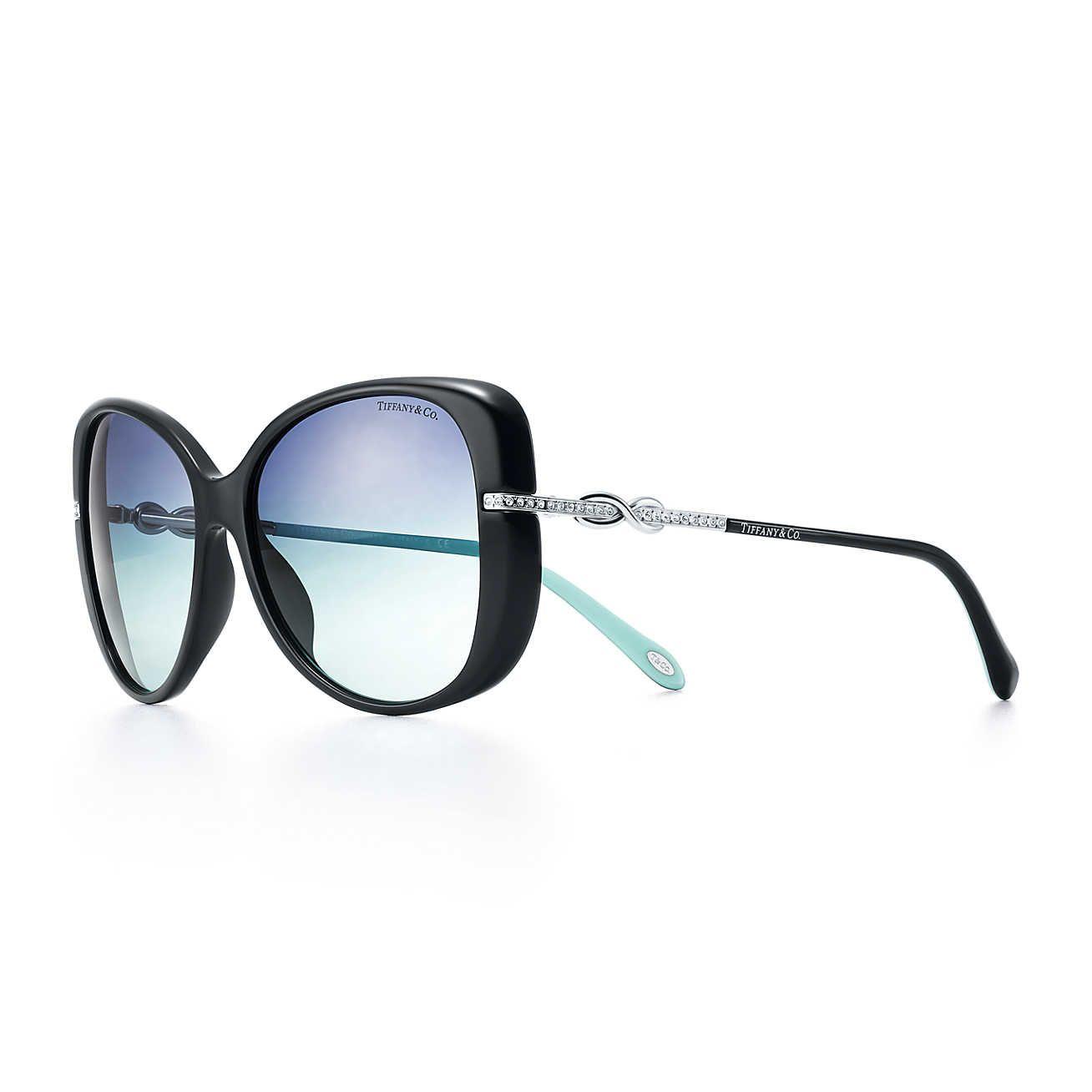 3da8e85dffc1 Tiffany Infinity butterfly sunglasses in black and Tiffany Blue acetate.