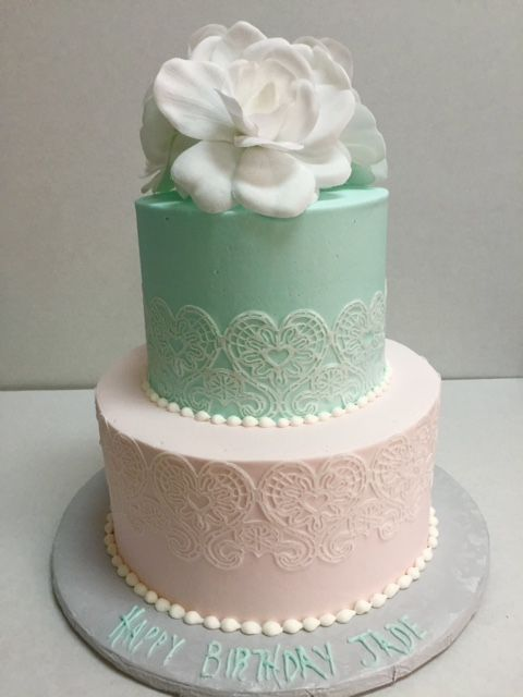 Buttercream icing with buttercream lace, birthday two tier cake.