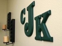 Painted MDF monogram in the Clarendon font, painted hunter green with a beveled edge.PRODUCTS USED:Painted Monogram Wood Letters