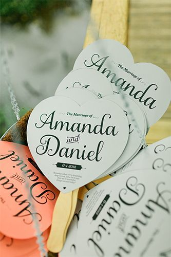 Coral and gray paper fans kept attendees cool at the ceremony. Stationery and Calligraphy: Daniel Cantada. #refinery29 http://www.refinery29.com/martha-stewart-weddings/4#slide-10