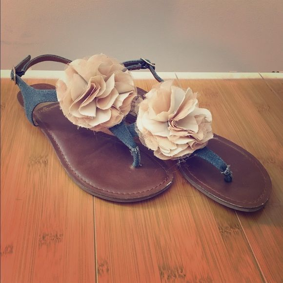 Sandals with adorable flower top. Sandals are denim material with tulle material Flower on top. Really adorable. Purchased and Worn once in an emergency when my sandal broke. Fergie Shoes Sandals