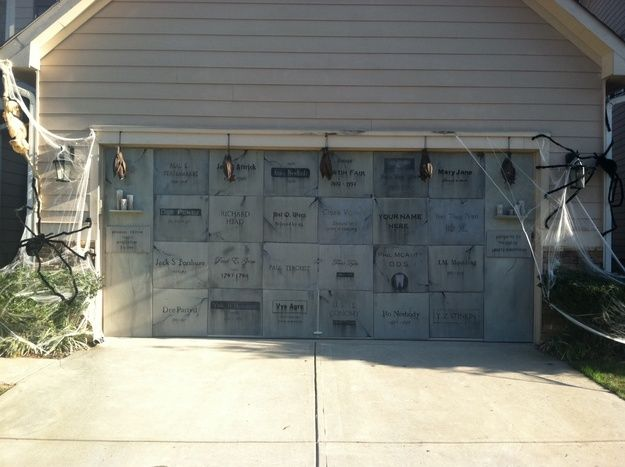 Garage door mausoleum made with foam board cut into individual - halloween garage ideas