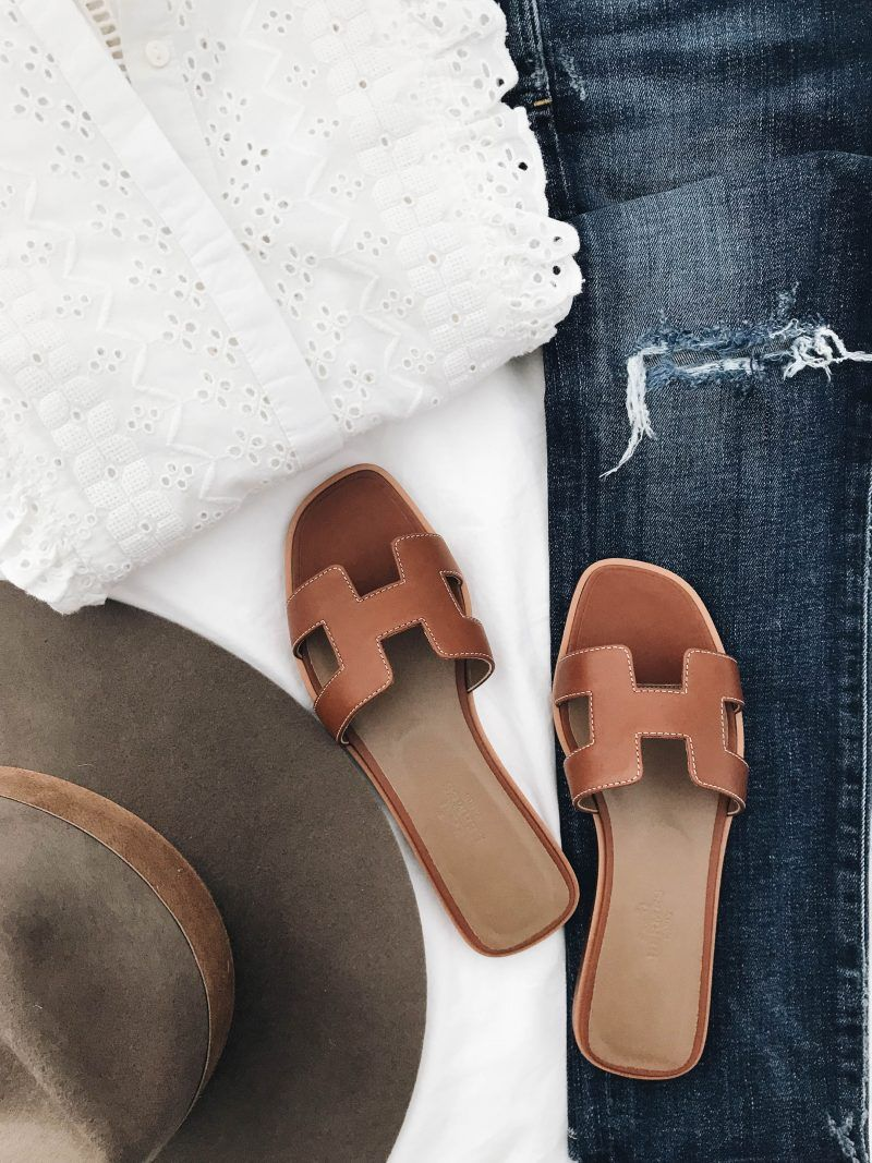 70000732df69 Flatlay with white eyelet top and brown cognac leather  Hermes Oran Sandals