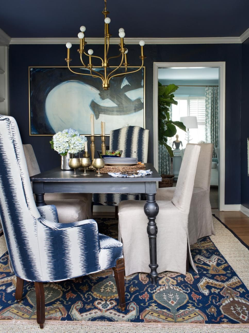 Blue Stain Wall Come With Beige Fabric Area Rug And Gold Ceiling Lamp Plus Varnished Dark Wood Dining Table Together Floor Tile