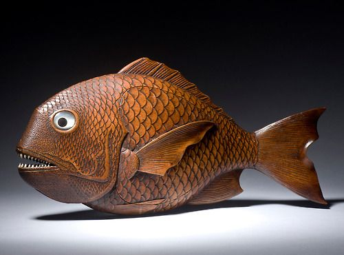 "Japan. Meiji period. 11"" - 28cm. An amusing model of a snapper fish. His scales intricately carved overall, with sharp inlaid teeth and Mother-o-Pearl eyes. The main body forming a gilt lacquer box."