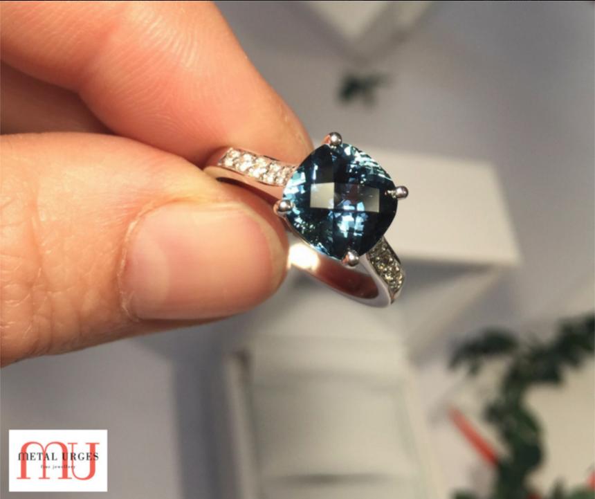 Exquisite checkerboard sapphire with grain set diamonds