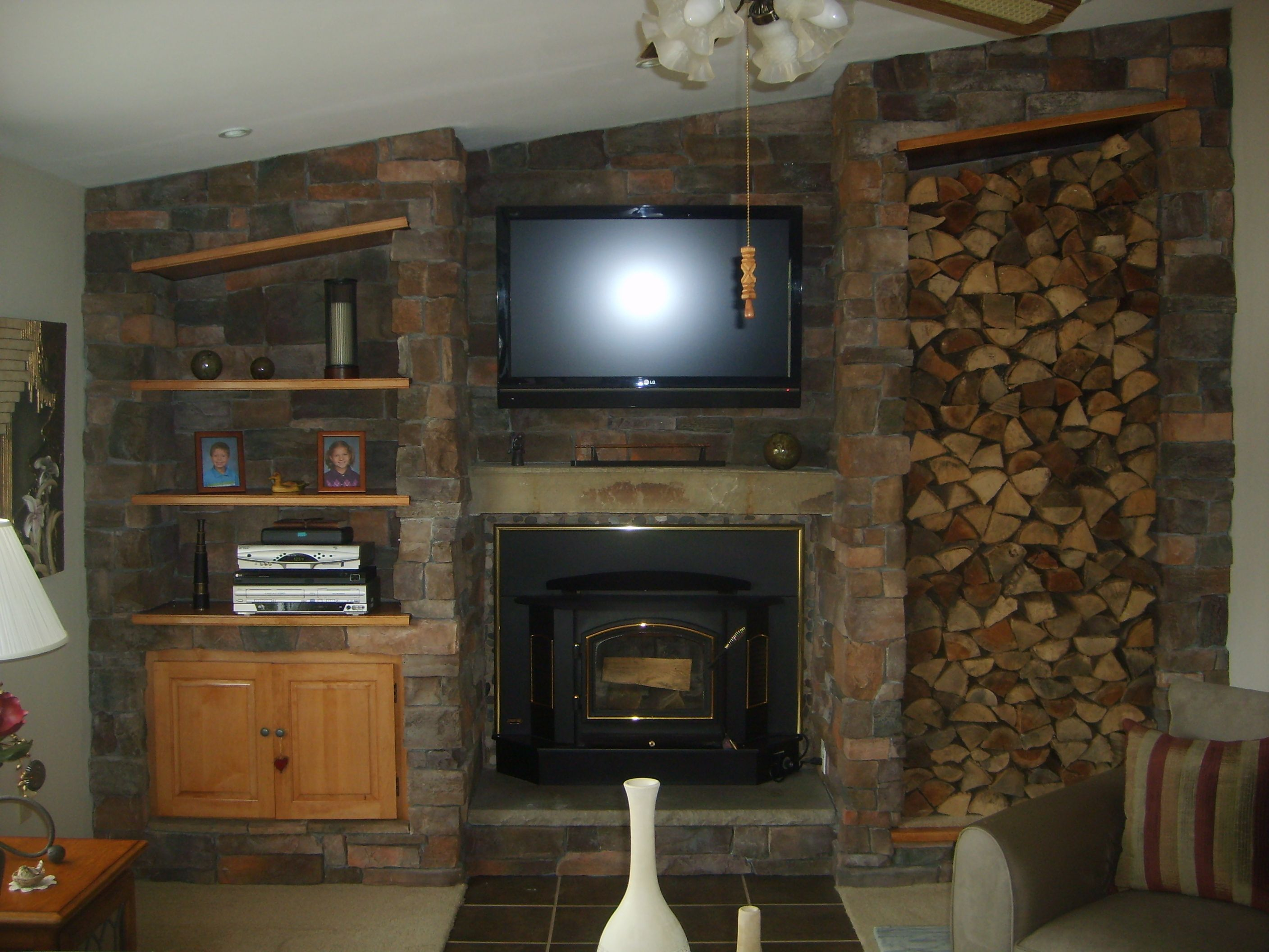 Custom Stone Fireplaces. Custom Stone Fireplace with Shelves  cupboard and wood box Woodstove