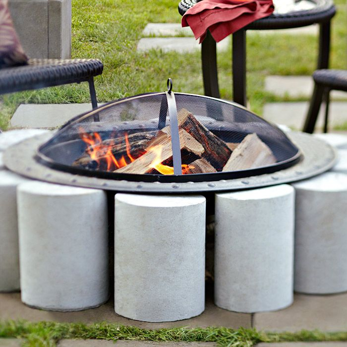 Incorporate A Freestanding Fire Pit Into Your Patio With A Ring Of Concrete  Cylinders.