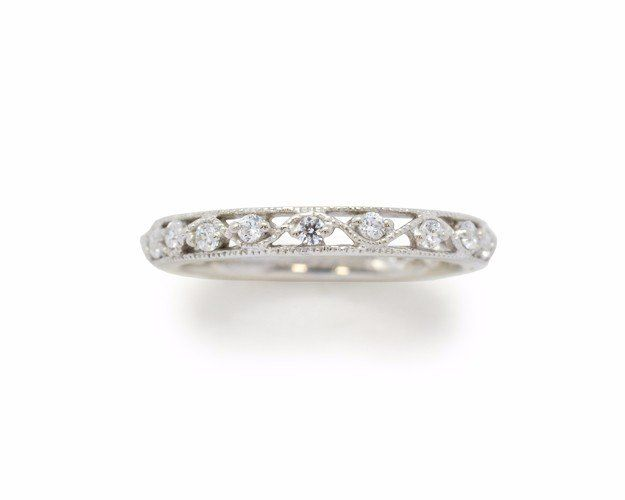 Filigree wedding band with 0.30TW in genuine brilliant-cut diamonds.  Available in 10k, 14k, and 18k rose, white or yellow gold and platinum.