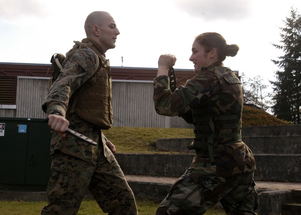 Marine Corps Sgt. Ty Drage, left, from Marine Corps Security Force ...