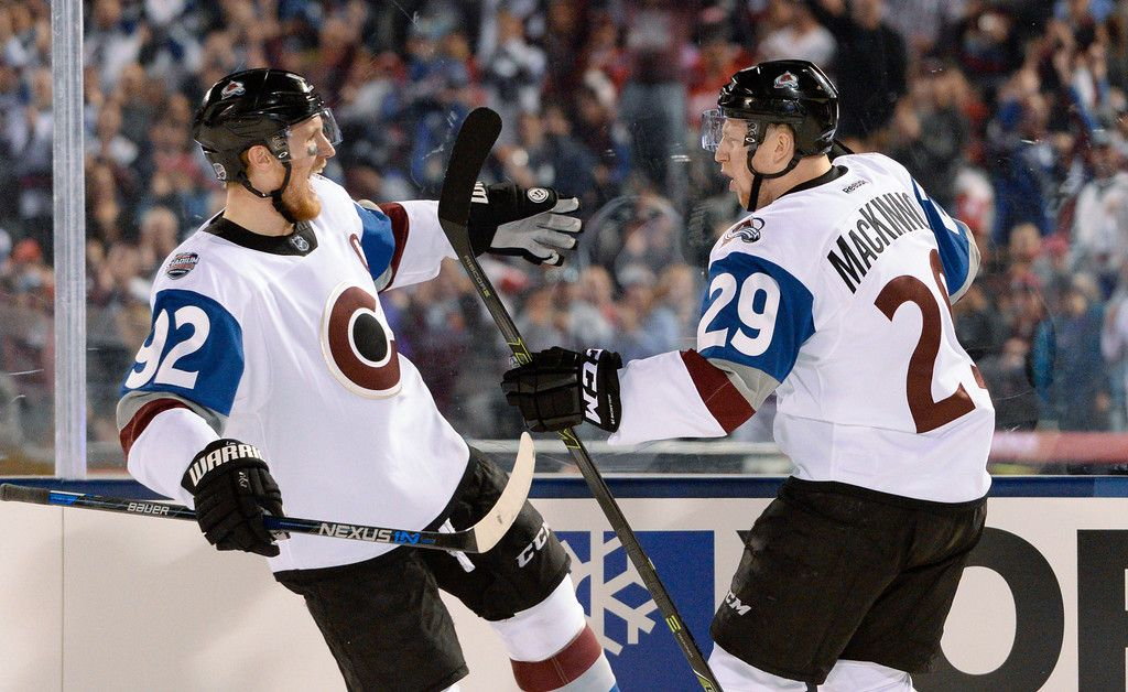 057429fc4 Colorado Avalanche center Nathan MacKinnon (29) celebrates his goal with  Colorado Avalanche left wing Gabriel Landeskog (92) against the Detroit Red  Wings ...