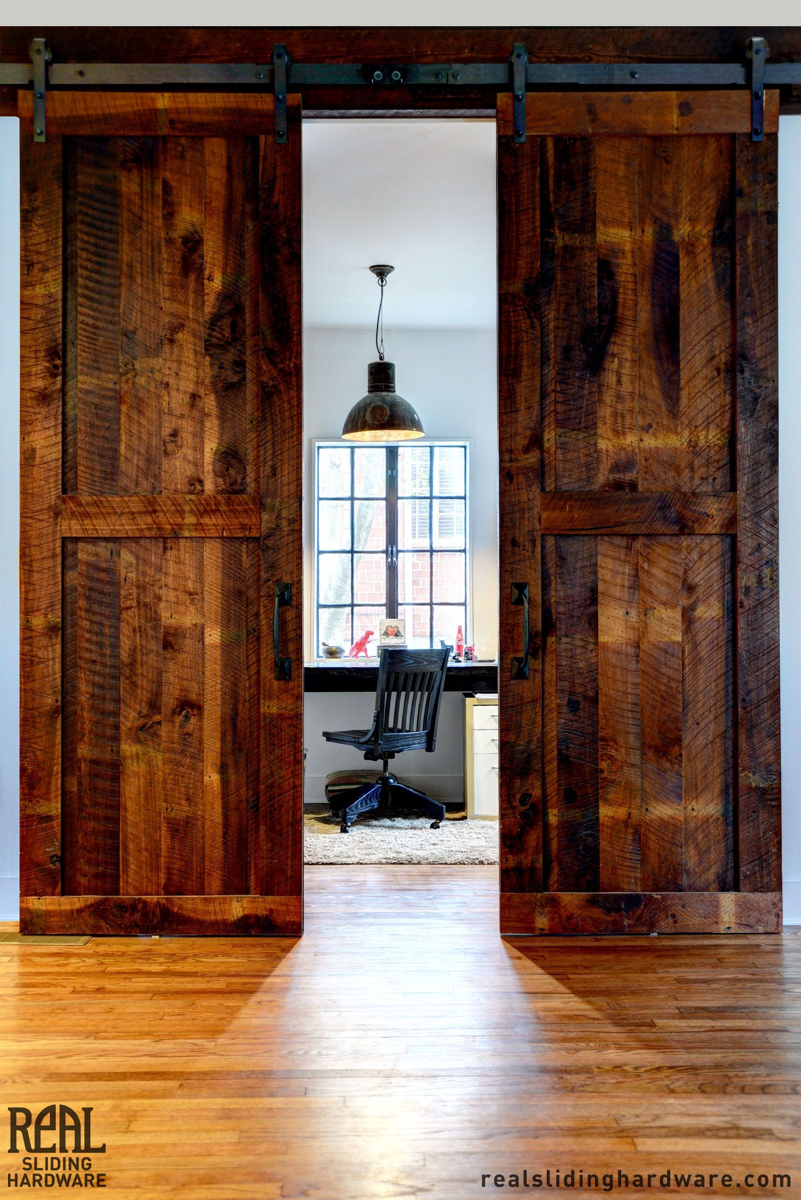 Classic Flat Track On Tall Bi Parting Doors Separates An Office