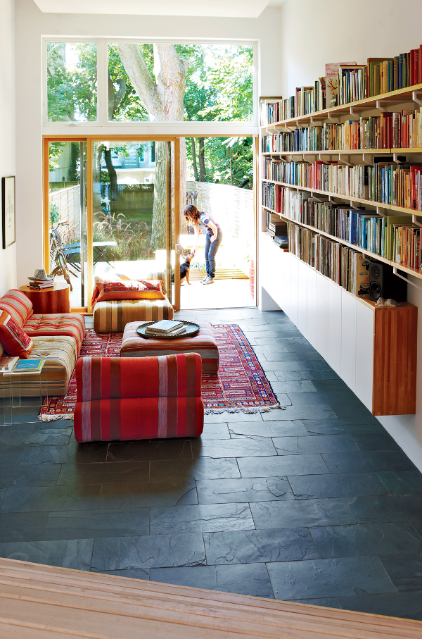 slate floor in a living room context this for basement walk out under deck to extend the feel of the family room modern living room with textured black - Slate Cafe Ideas