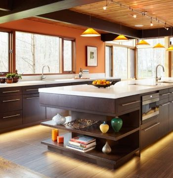 Contemporary Galley Style Burnt Orange kitchen, walnut cabinets
