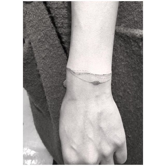 100 Latest Bracelet Tattoo Designs For Ladies: 30 Tiny, Chic Wrist Tattoos That Are Better Than A