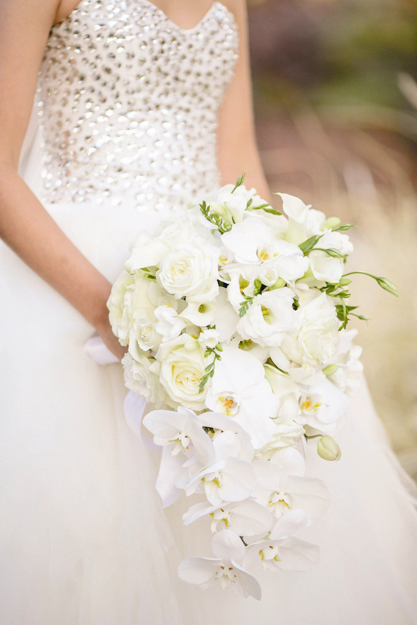 Kelly says she wanted something out of the ordinary so she chose a white cascade bridal bouquet mightylinksfo