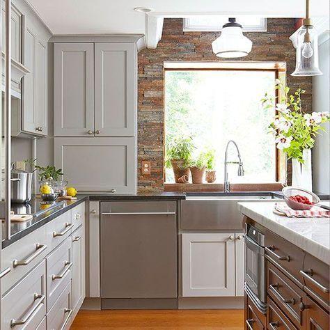 grey kitchen cabinets + carrara marble top island + window herb pots