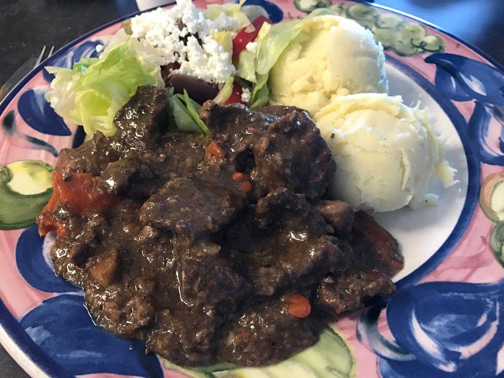 Beef bougiugnon with mashed potatoes and Greek salad Foodspotting at Beyond Food