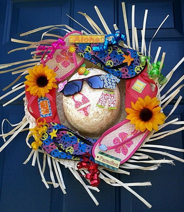 Fun Flip Flop Summer Wreath. Flip flops, sunglasses, shorts, hats have always been a sign of summer. Add a splash of color to your home with this creative and fun flip flop wreath on your door during this summer.