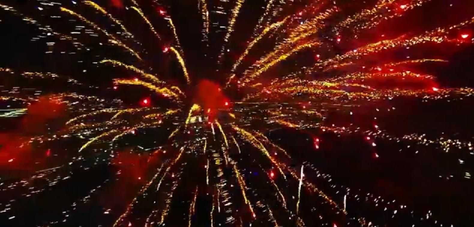 Screen capture 3/3: #Fireworks as filmed from a drone. This awesome video has gone viral, as well it should—it's magnificent! Watch it here: http://youtu.be/a9KZ3jgbbmI