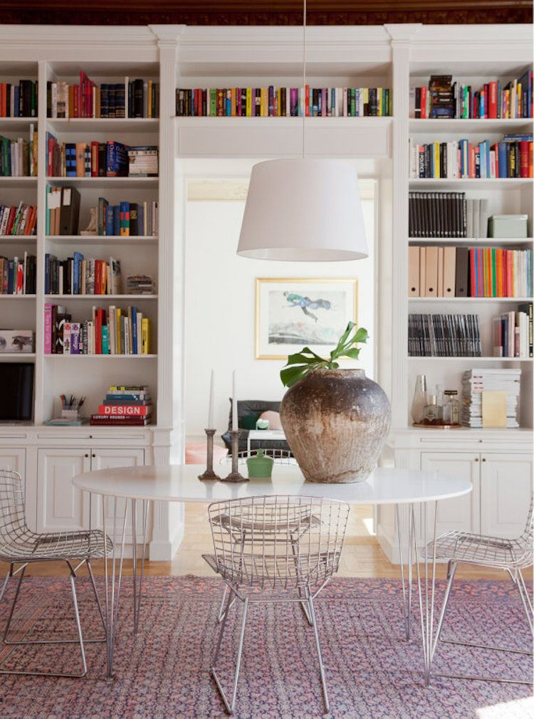 Cosy Dining Room With Floor To Ceiling Built In Bookcase And Storage But A Minimal Tidy Eating Area